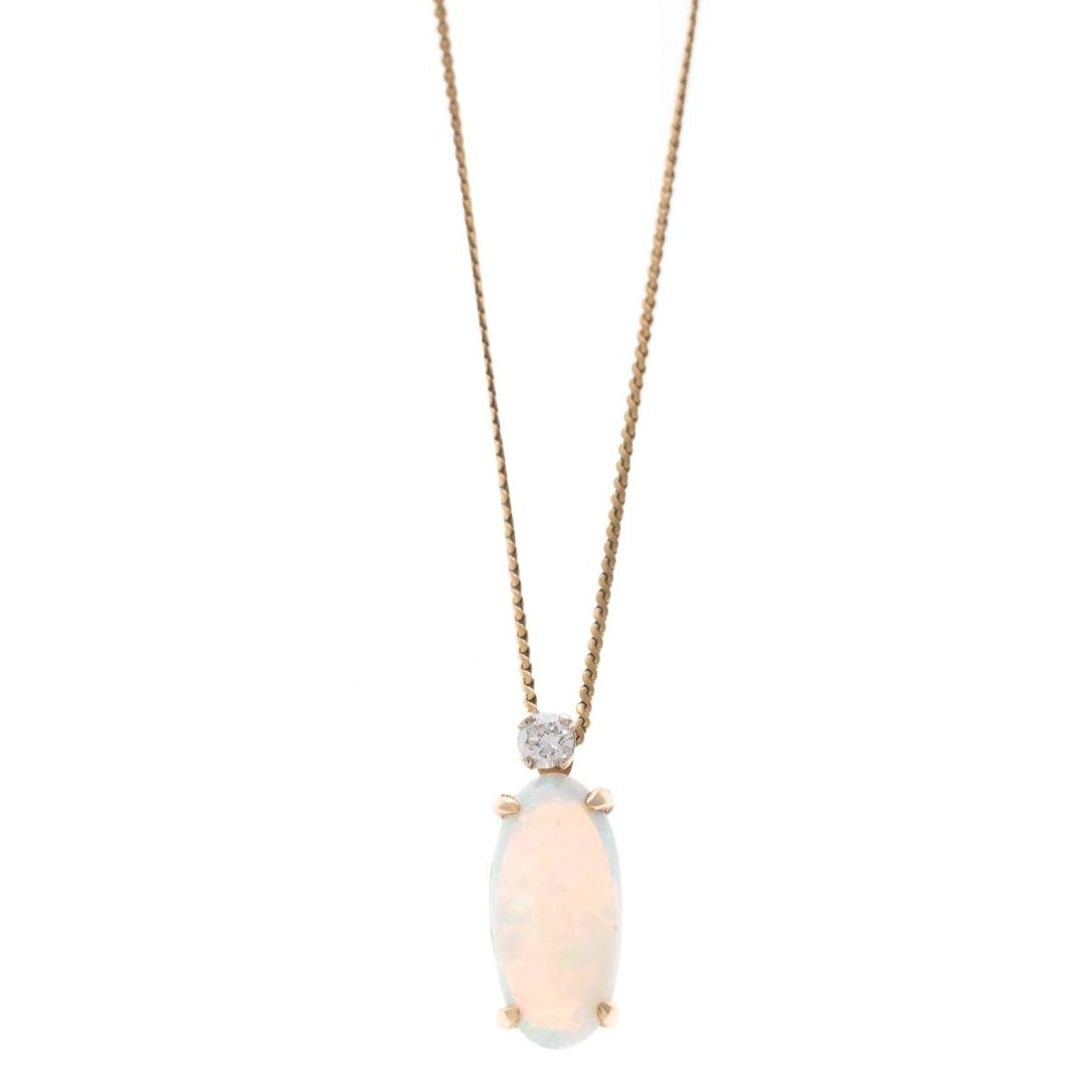 A Lady's 18K Opal and Diamond Pendant - 2