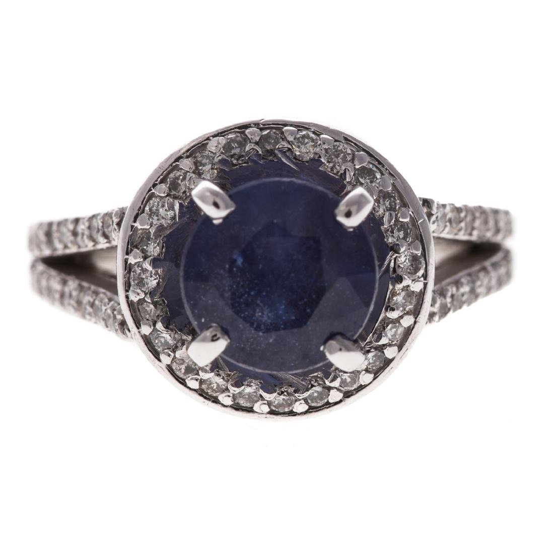A Lady's Platinum and Diamond Ring