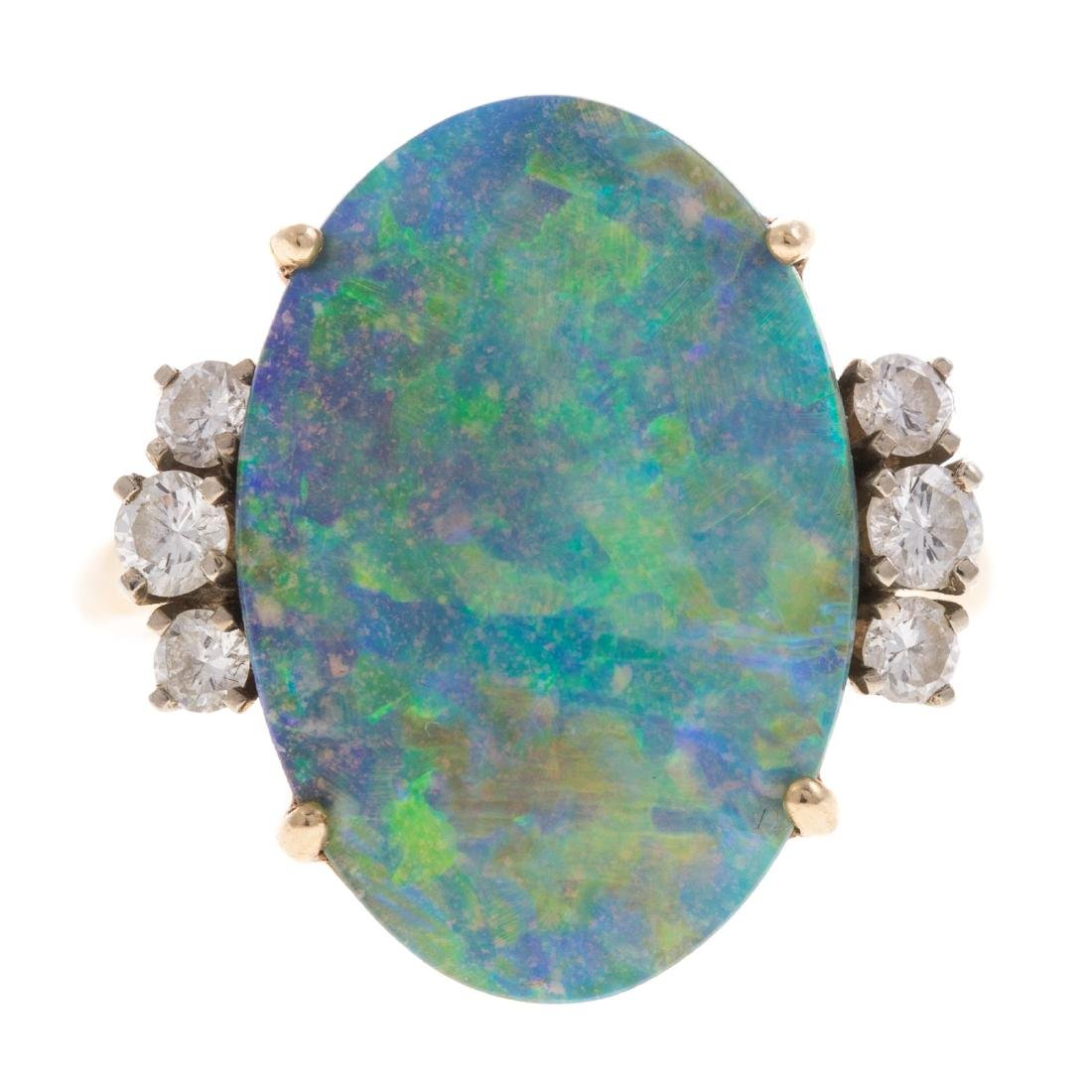 A Lady's 14K Opal and Diamond Ring