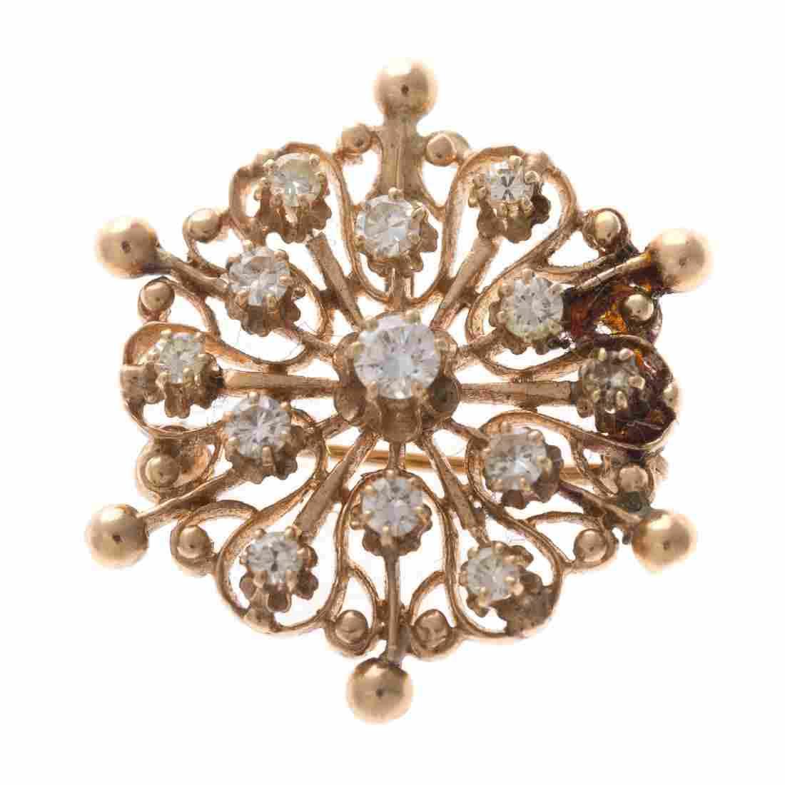 A Lady's Victorian 14K Diamond Starburst Brooch