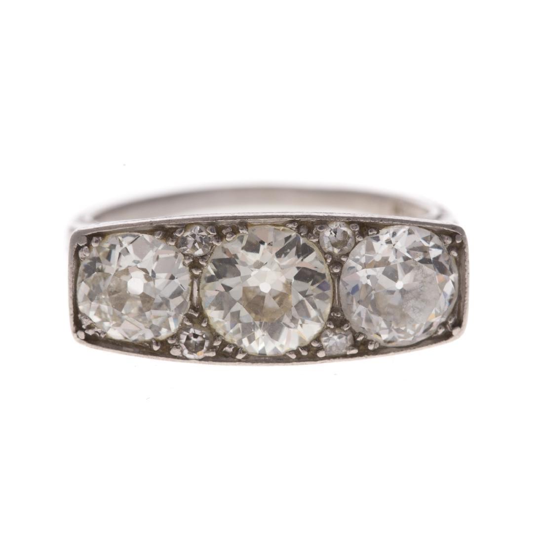 An Art Deco Filigree Diamond Ring in Platinum
