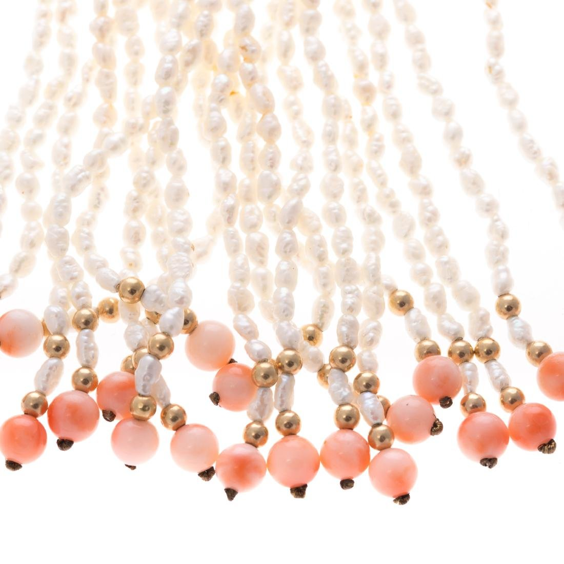 A Strand of Freshwater Pearls & Carved Coral - 2
