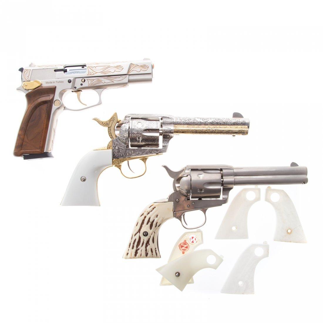 Three assorted prop guns