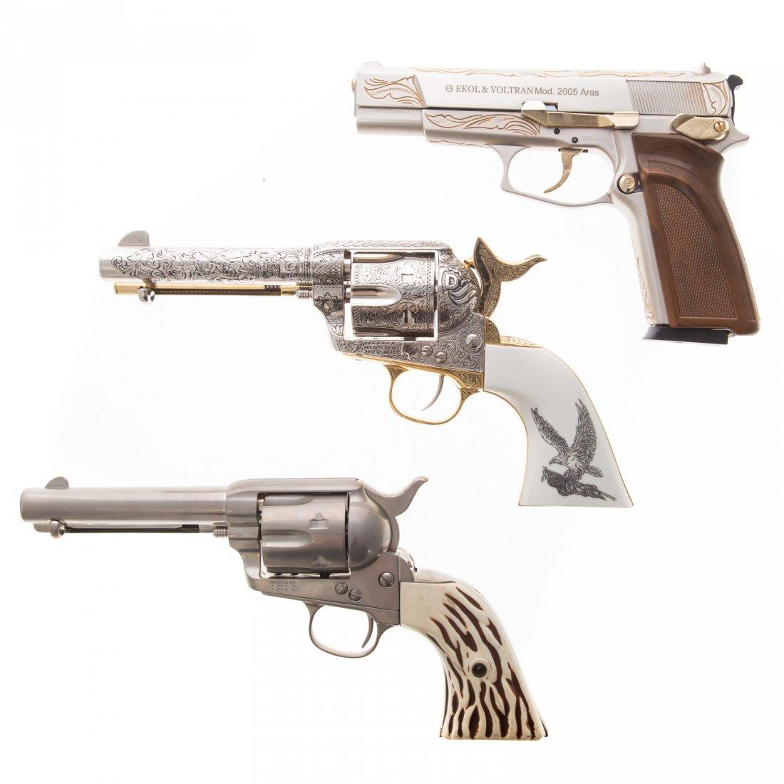 Three assorted prop guns - 3
