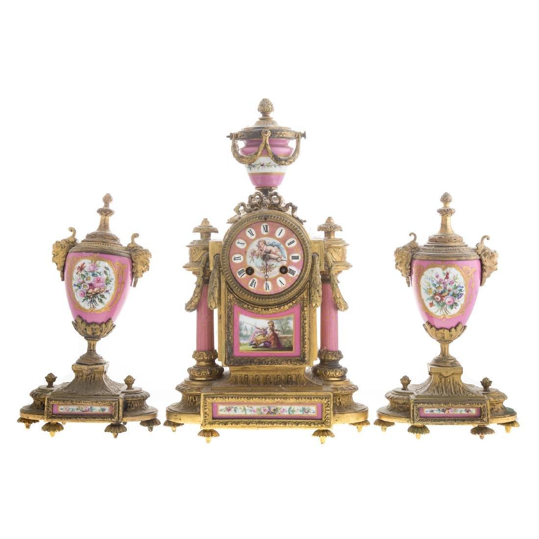 Phillipe H. Mourey gilt-metal clock garniture