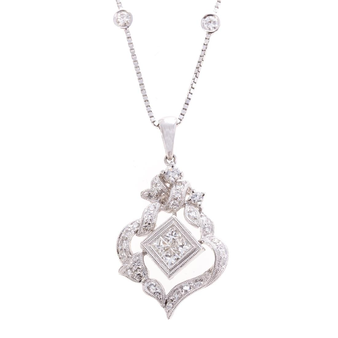 A Lady's Diamond Filigree Pendant in White Gold