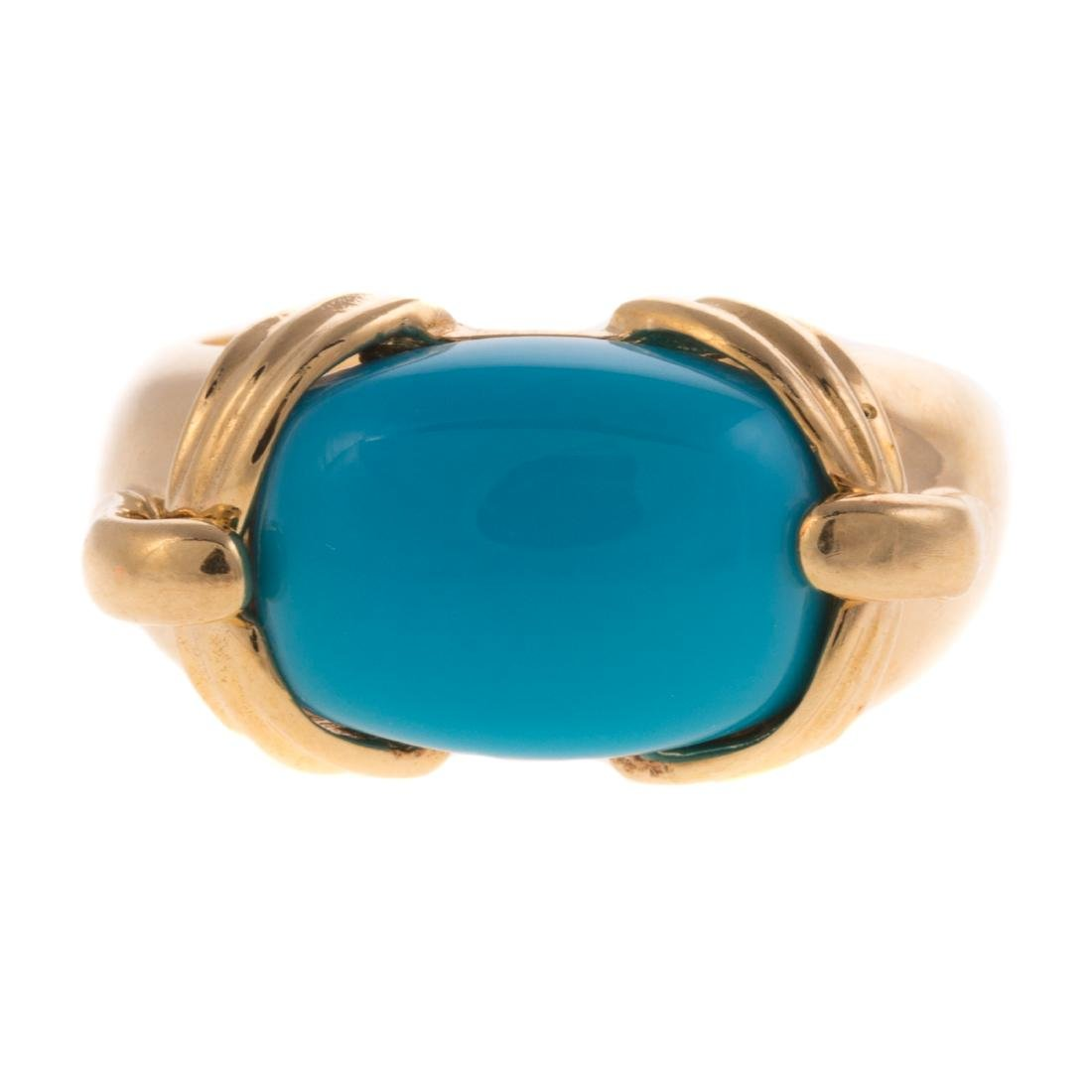A Lady's Sleeping Beauty Turquoise Ring in 18K