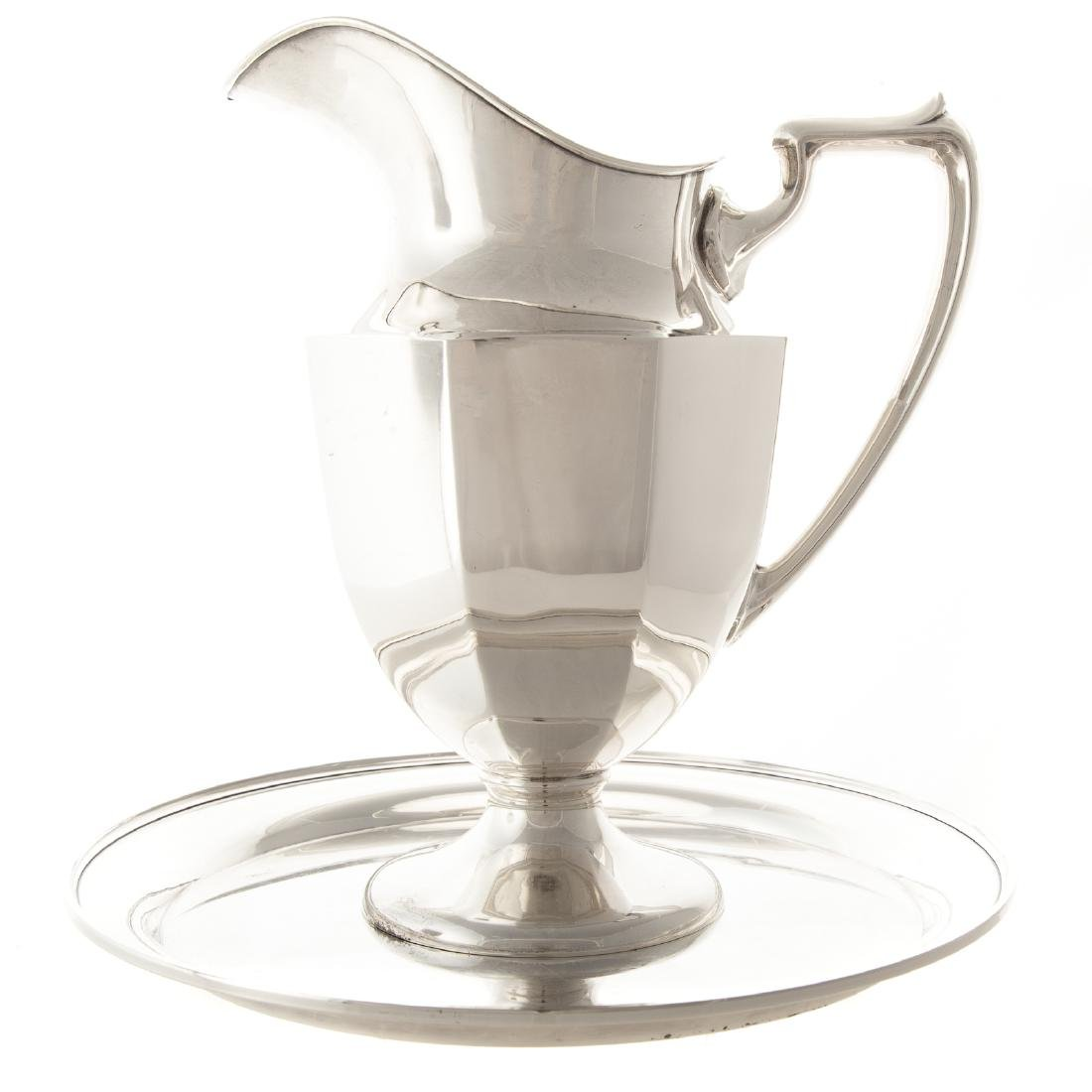 American sterling water pitcher and a tray