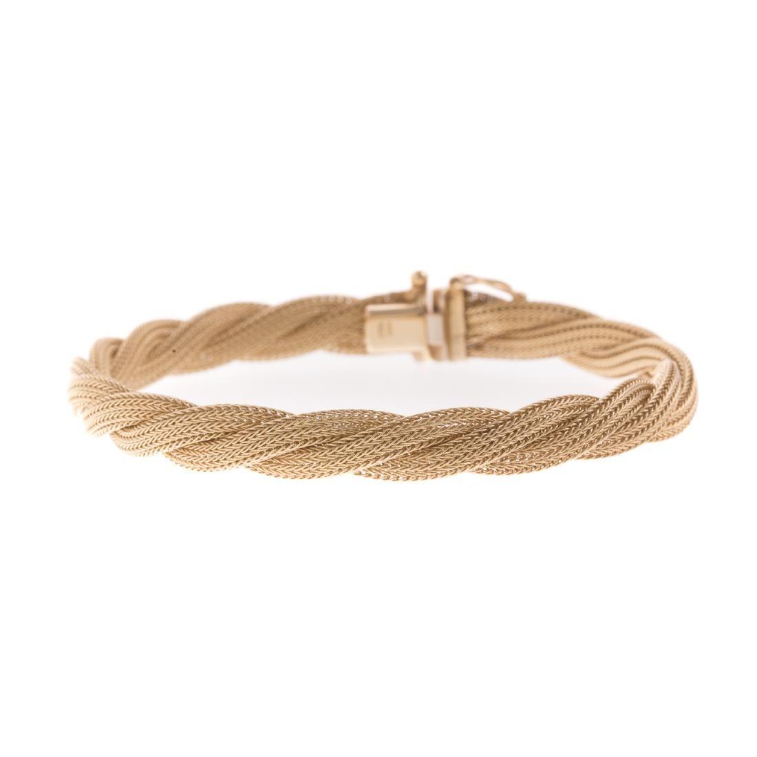 A Ladies 14K Twisted Woven Bracelet