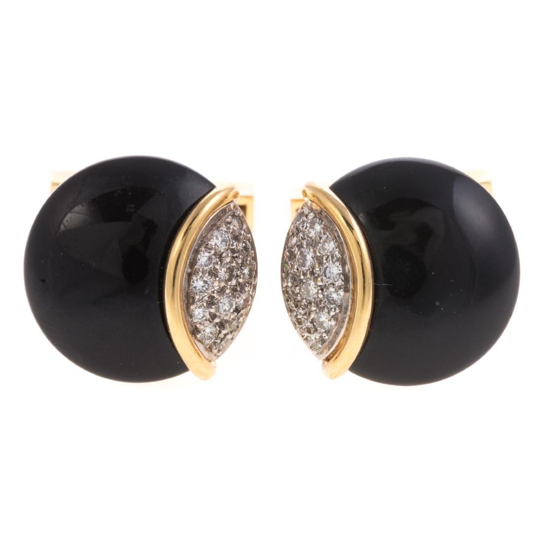 A Pair of Gent's Black Onyx & Diamond Cufflinks