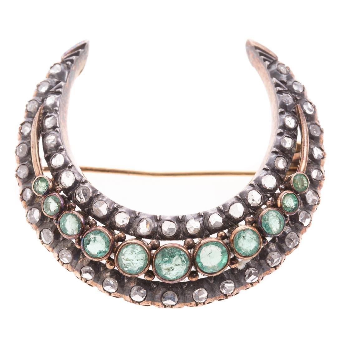 An Edwardian Emerald & Diamond Crescent Moon Pin