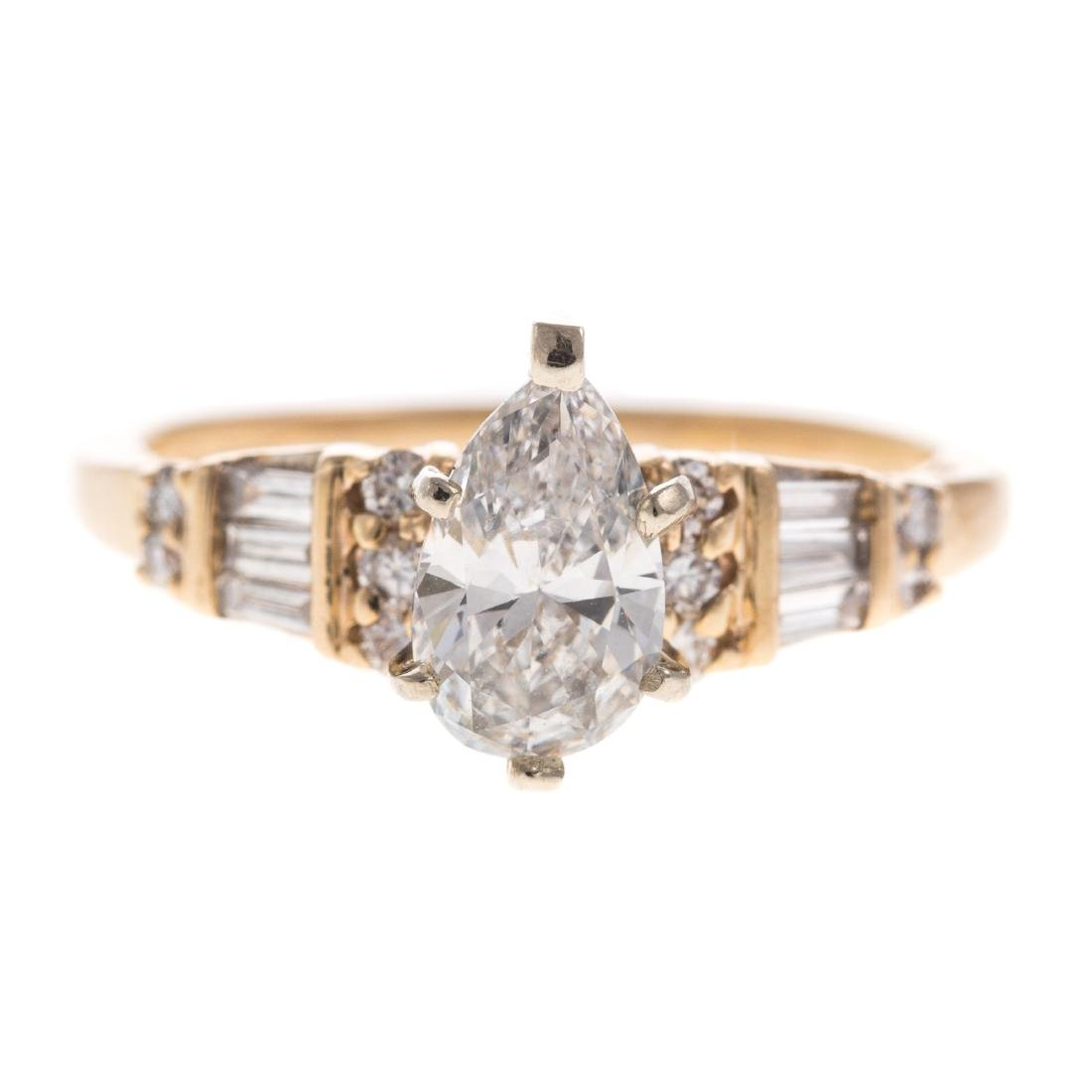 A Ladies Pear Shaped Diamond Ring in 14K