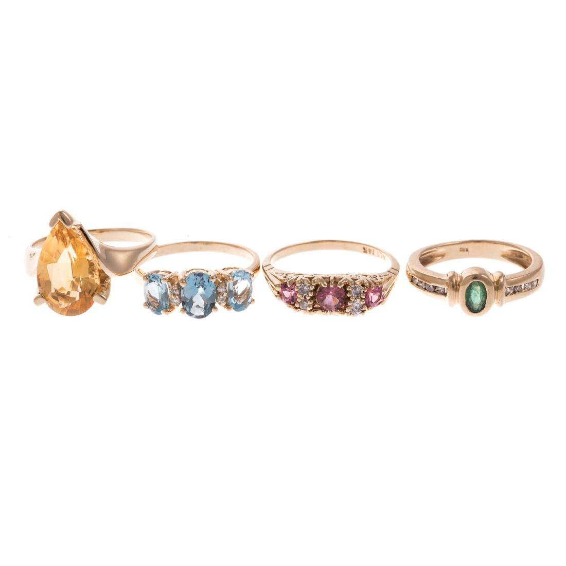 A Collection of 4 Gold Gemstone Rings