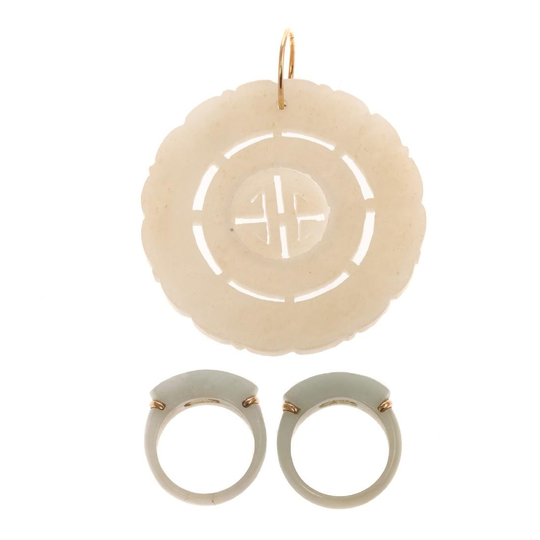 A Ladies Jade Pendant and Two Jade Rings