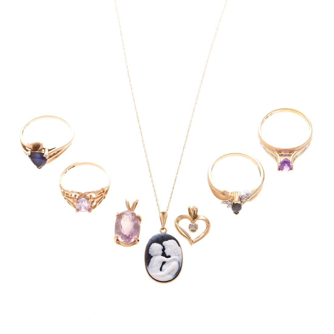 A Collection of Gold Pendants and Rings