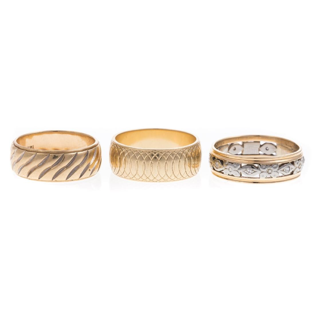 A Trio of Ladies Gold Wide Wedding Bands
