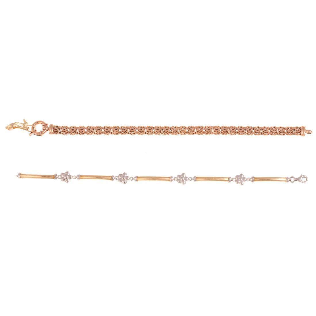 A Pair of Ladies 14K Gold Bracelets