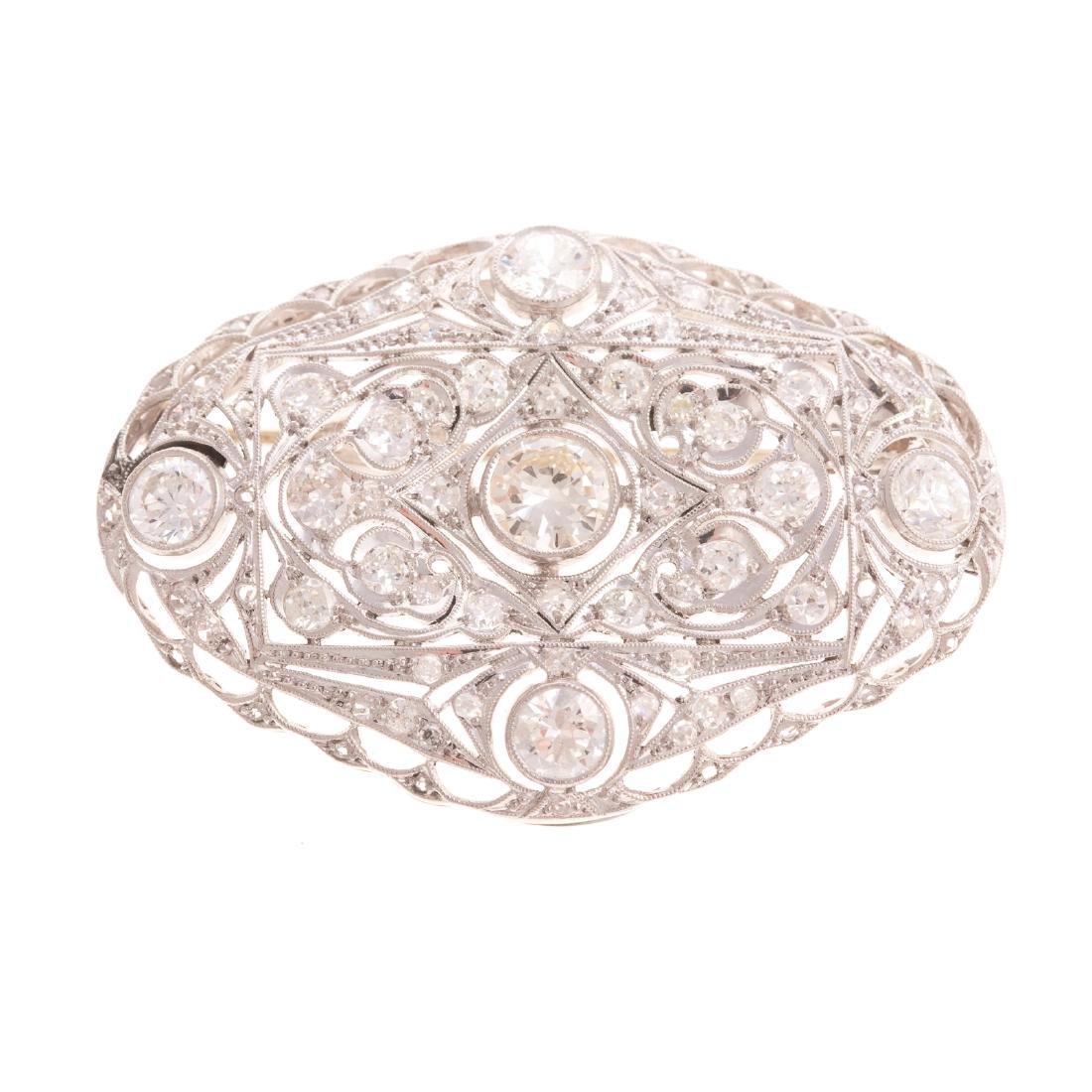 An Art Deco Diamond Filigree Brooch in Platinum