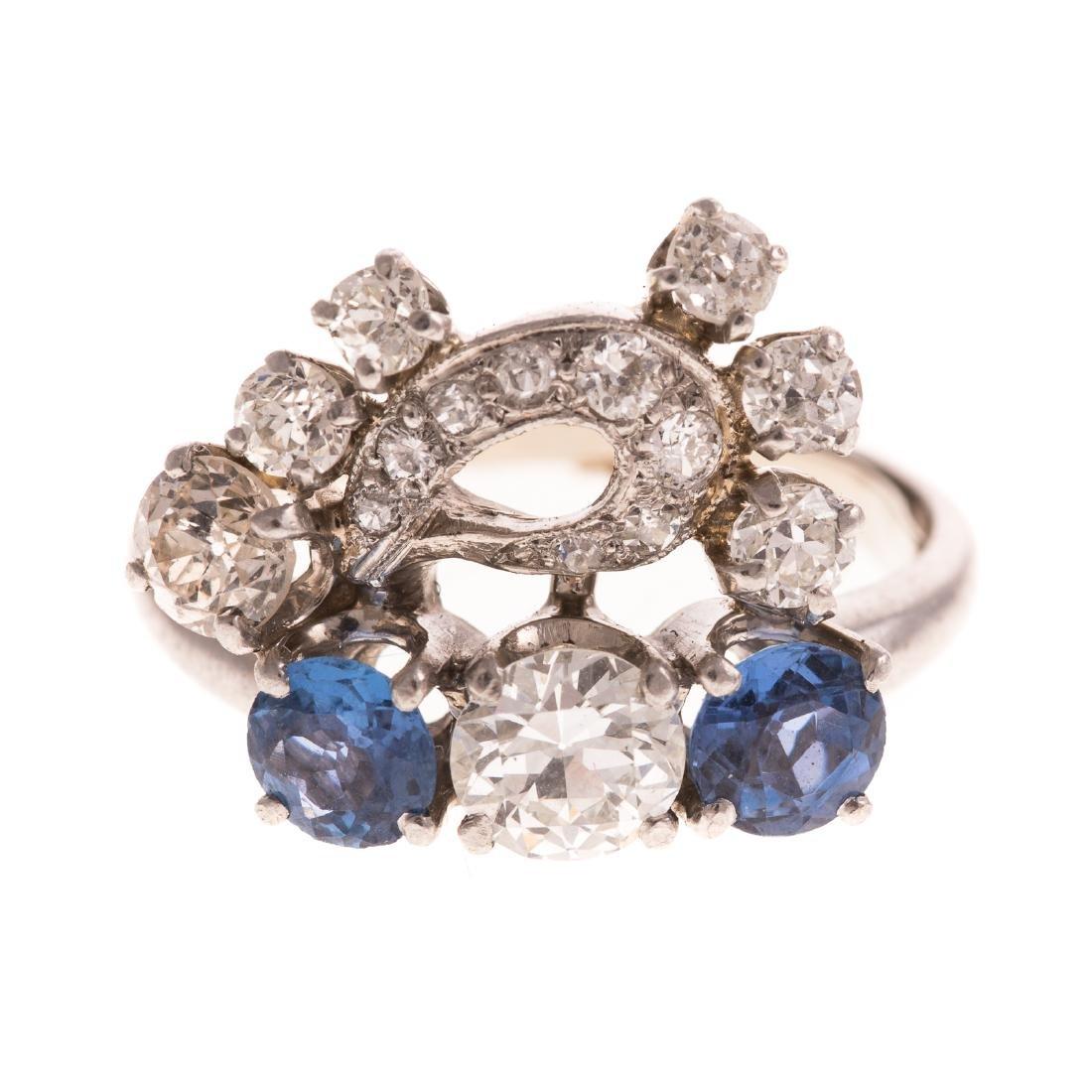 A Ladies Diamond & Sapphire Ring in Platinum