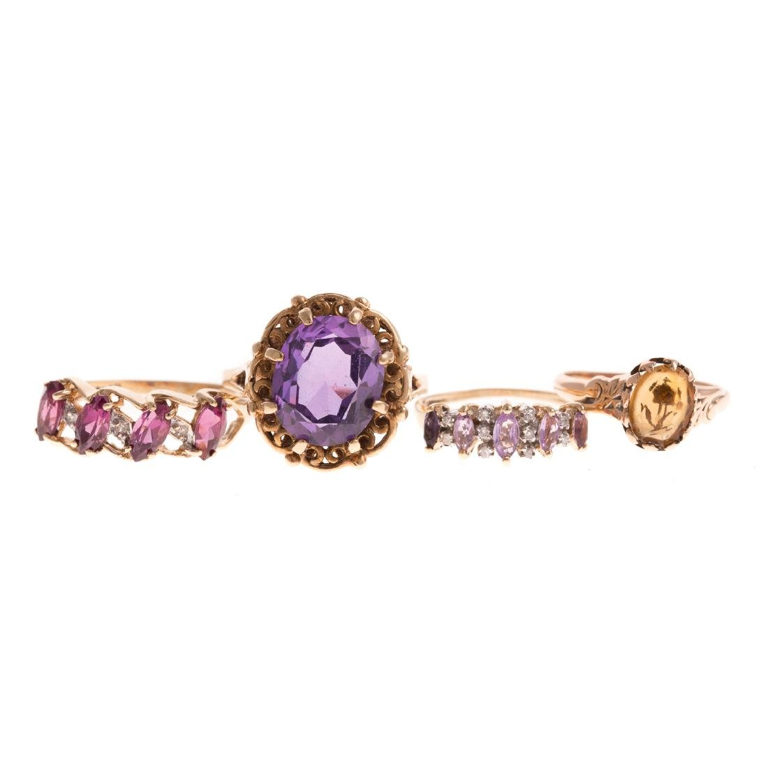 A Collection of Ladies Gemstone bands in Gold