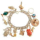 A Ladies Bracelet with 14 Large Gold Charms