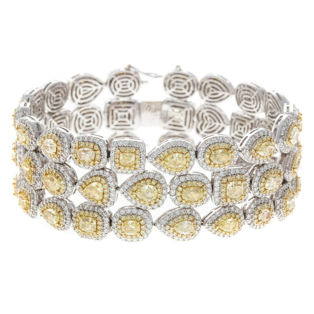 A 31.21ct Yellow & White Diamond Bracelet in 18K
