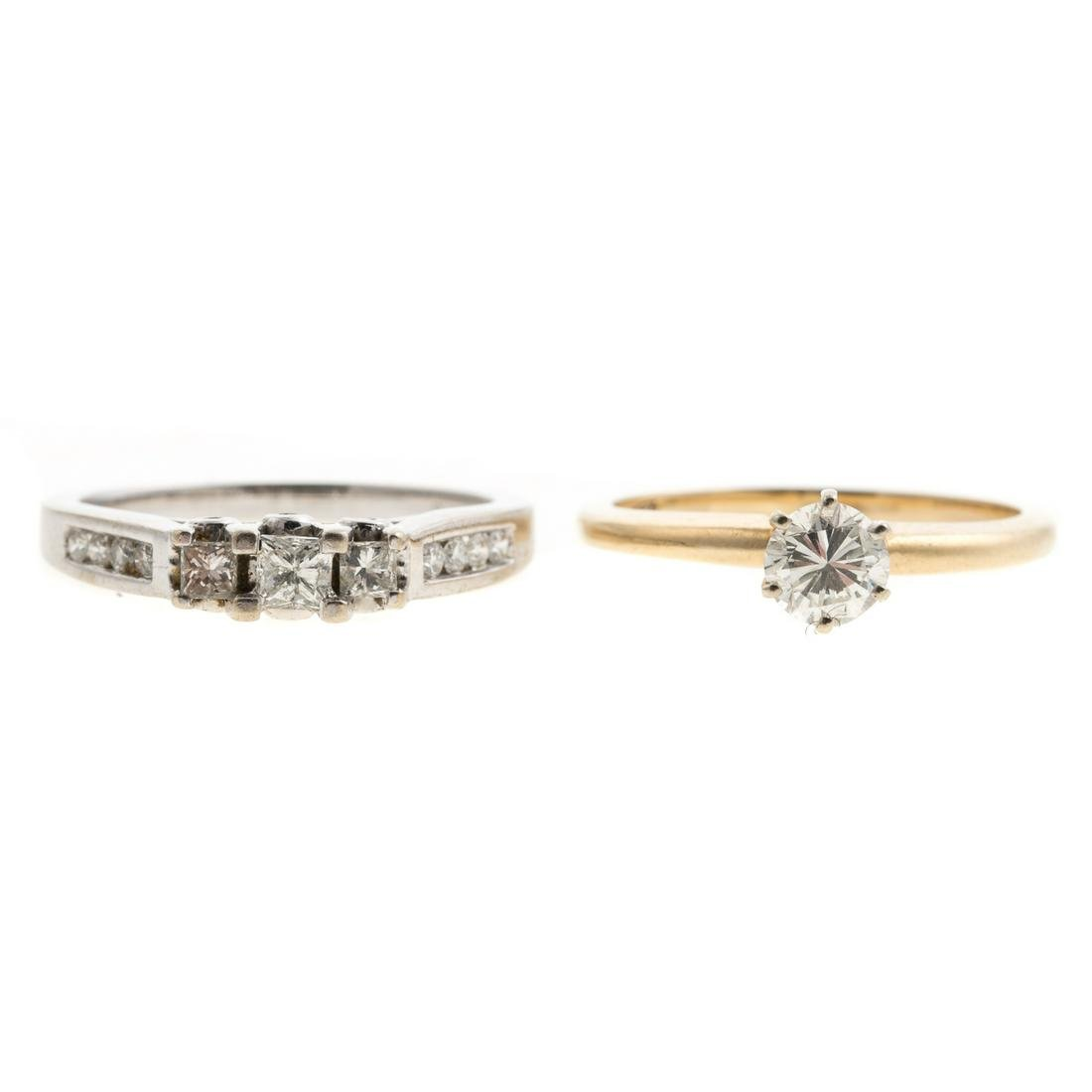 A Pair of Ladies Diamond Engagement Rings in Gold