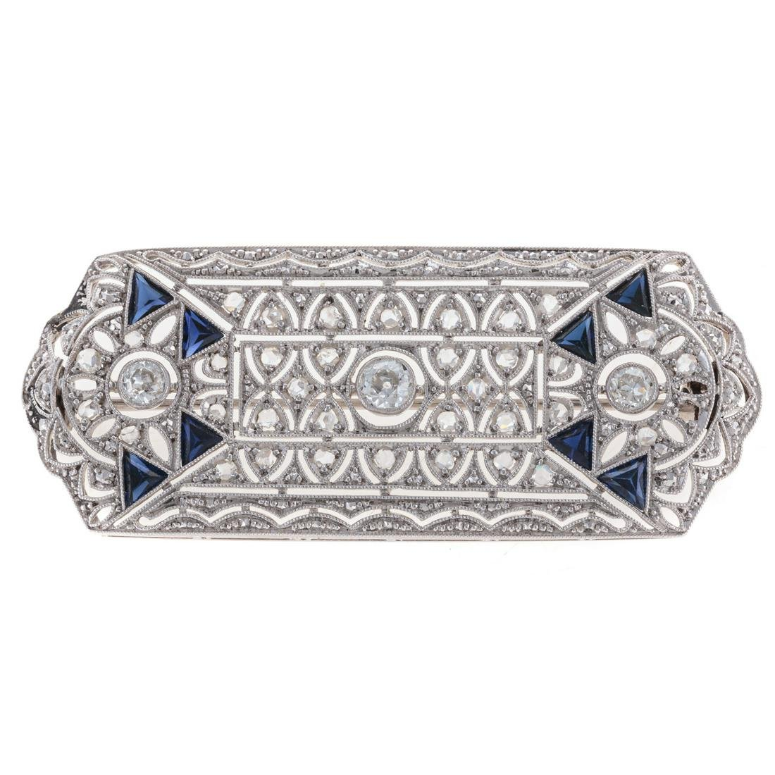 A Filigree Diamond & Sapphire Bar Pin in Platinum