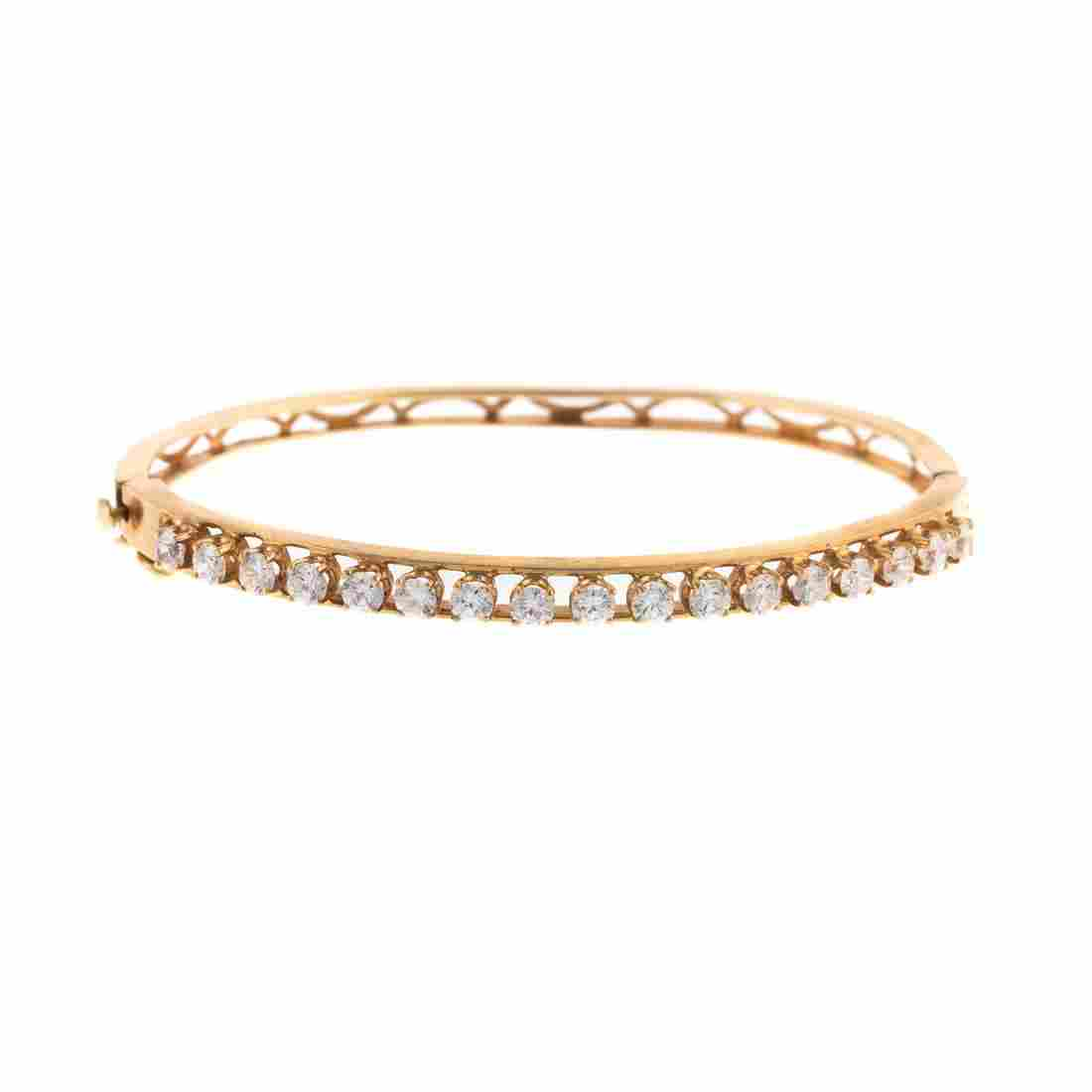 A Ladies Diamond Bangle Bracelet in 14K Gold