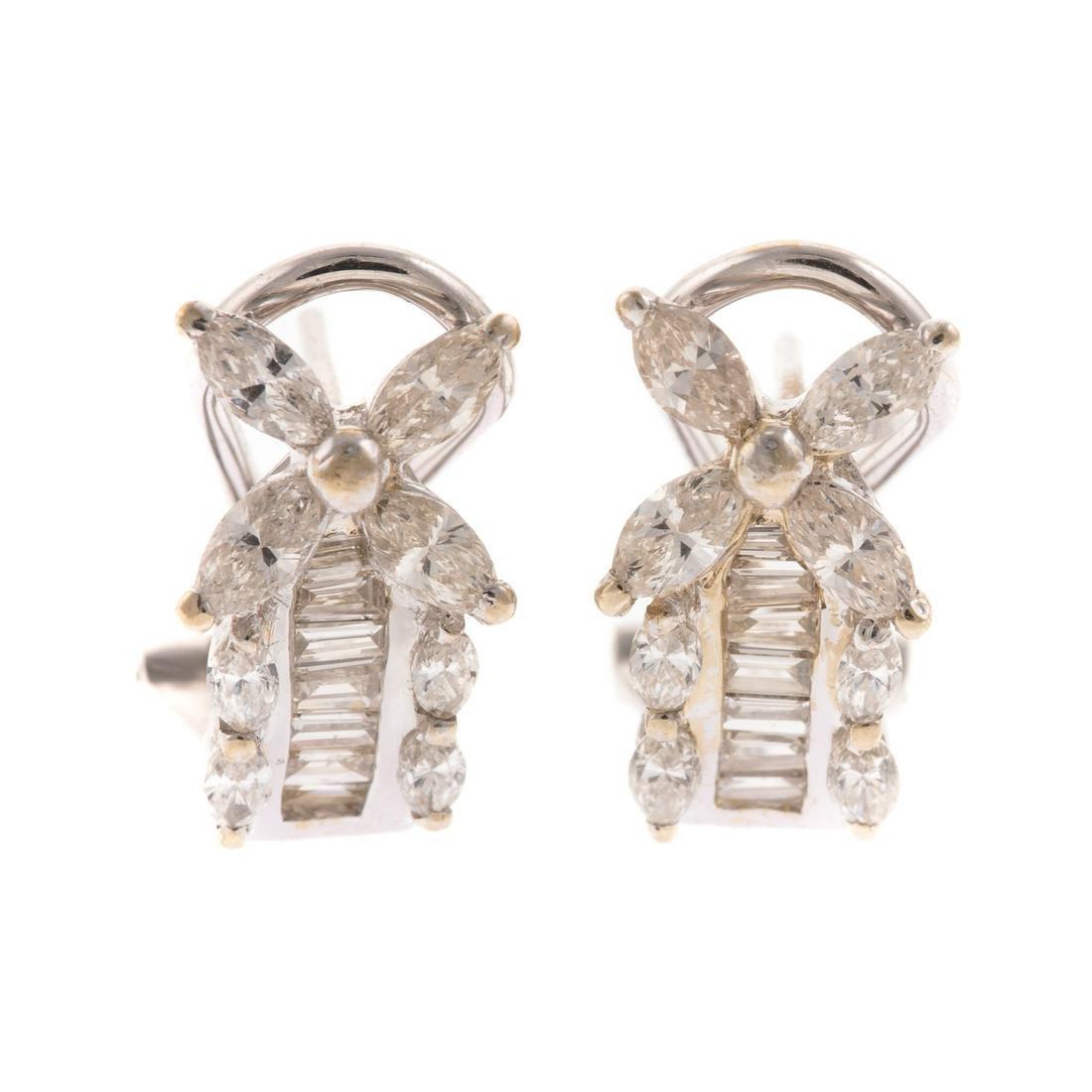 A Ladies Pair of Diamond Earrings in 18K Gold
