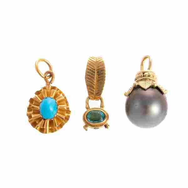 A Trio of Gemstone Pendants in Gold
