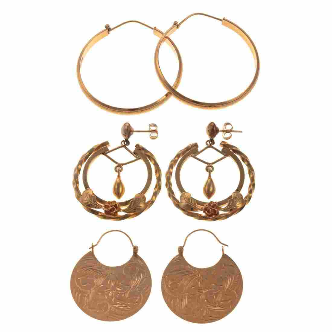 A Trio of Ladies Hoop Earrings in Gold