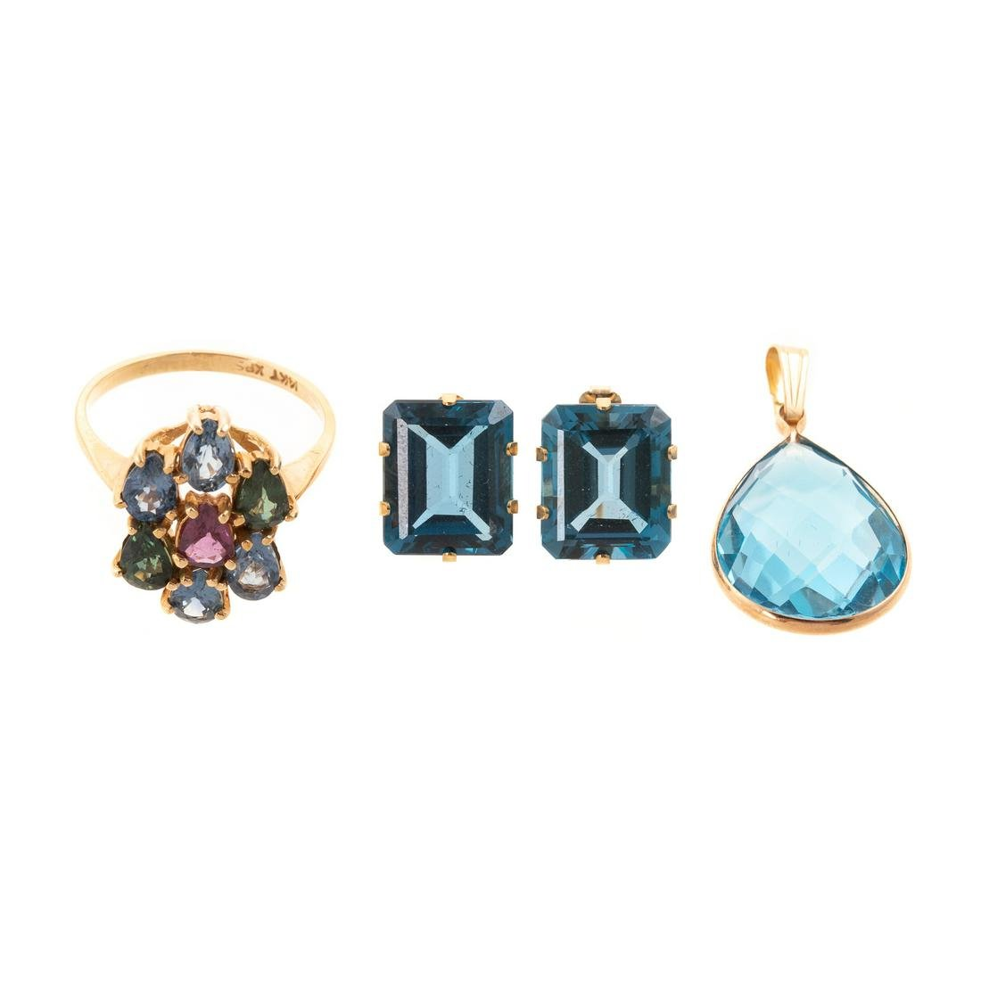 A Collection of Blue Topaz Jewelry in Gold