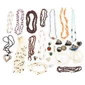 A Collection of Beaded Necklaces & Pins