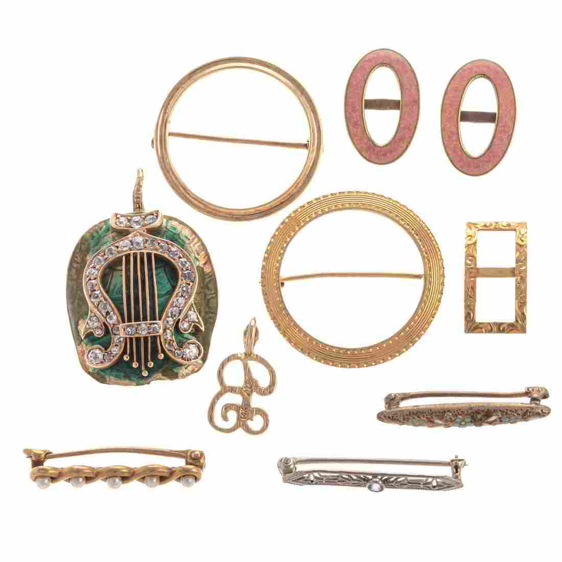 A Collection of Gold Brooches & More