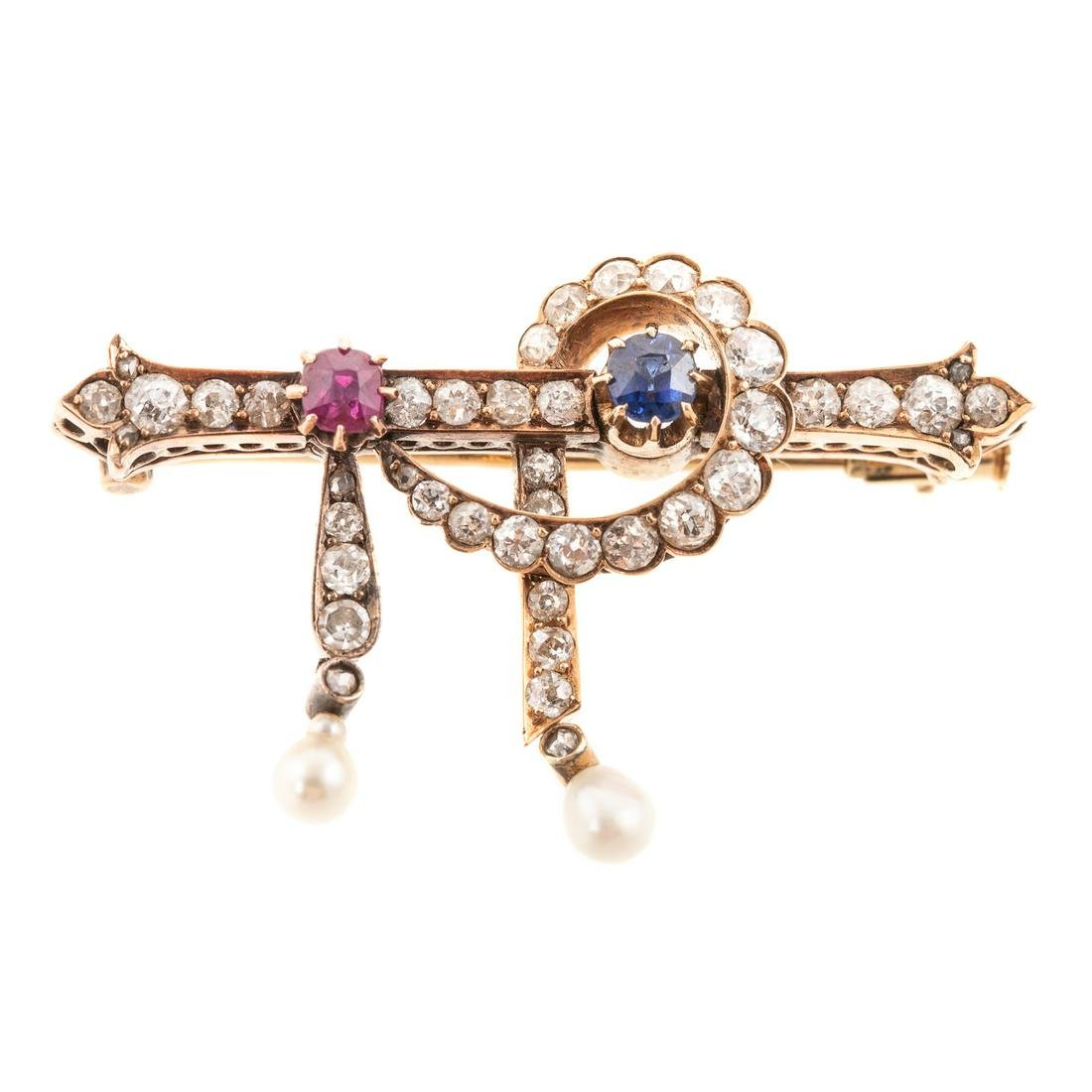 An 18K Antique Diamond, Ruby & Sapphire Brooch