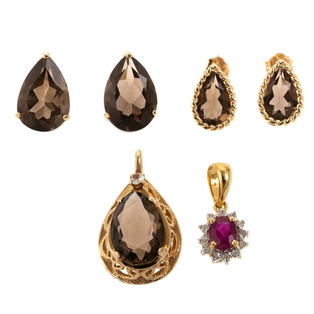 A Collection of Gemstone Jewelry in Gold