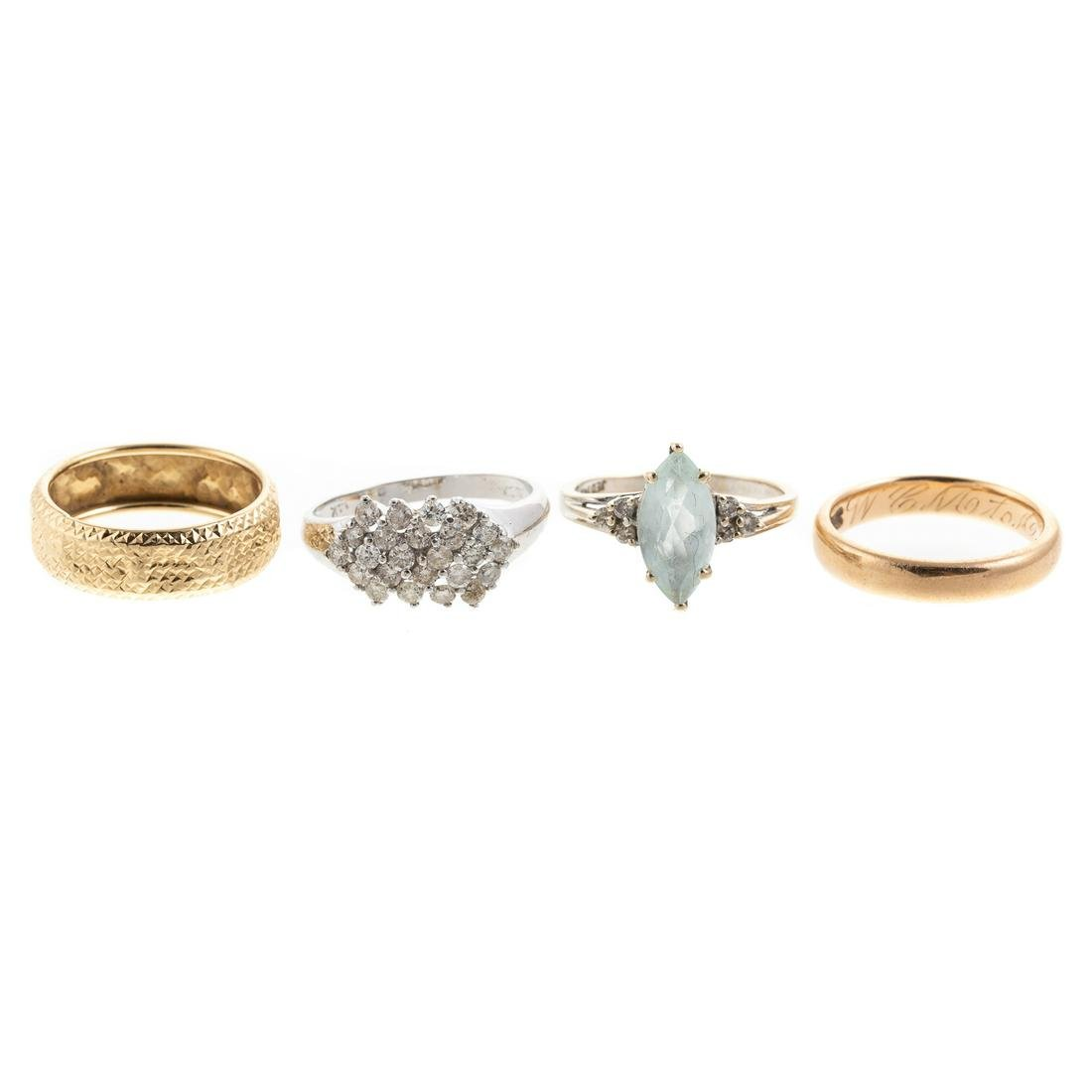 A Collection of Gold, Diamond & Blue Topaz Rings