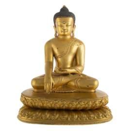 Highly Important Tibetan Gilt Bronze Seated Buddha