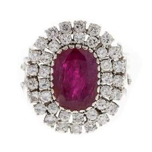A 3.00 ct Ruby & Diamond Halo Ring in 14K