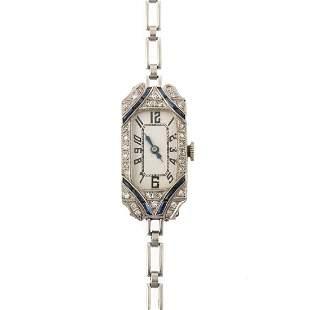 An Art Deco Diamond & Sapphire Watch in Platinum