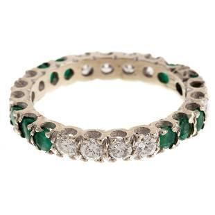 An Emerald & Diamond Eternity Band in 14K