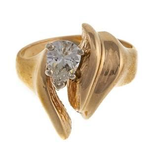 A Pear Shape Diamond Freeform Ring in 14K