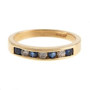 A Sapphire & Diamond Channel Set Band in 14K