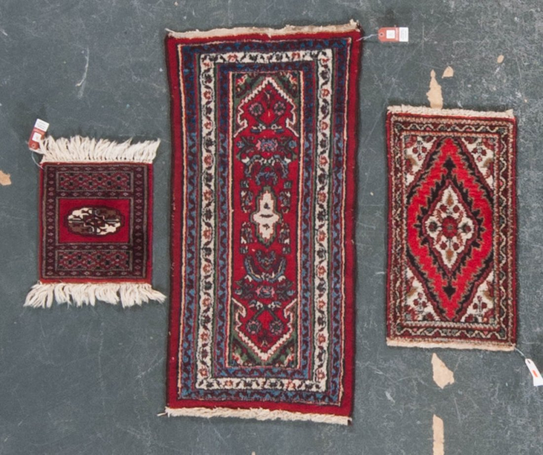 Three scatter rugs