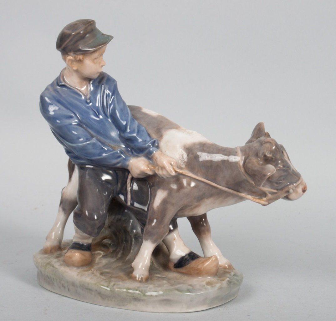 Royal Copenhagen boy and calf porcelain group