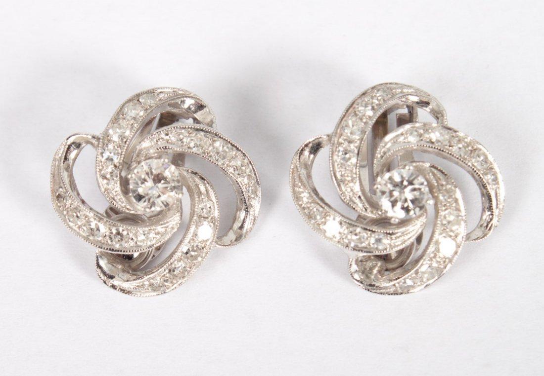 Lady's 14K white gold & diamond earrings
