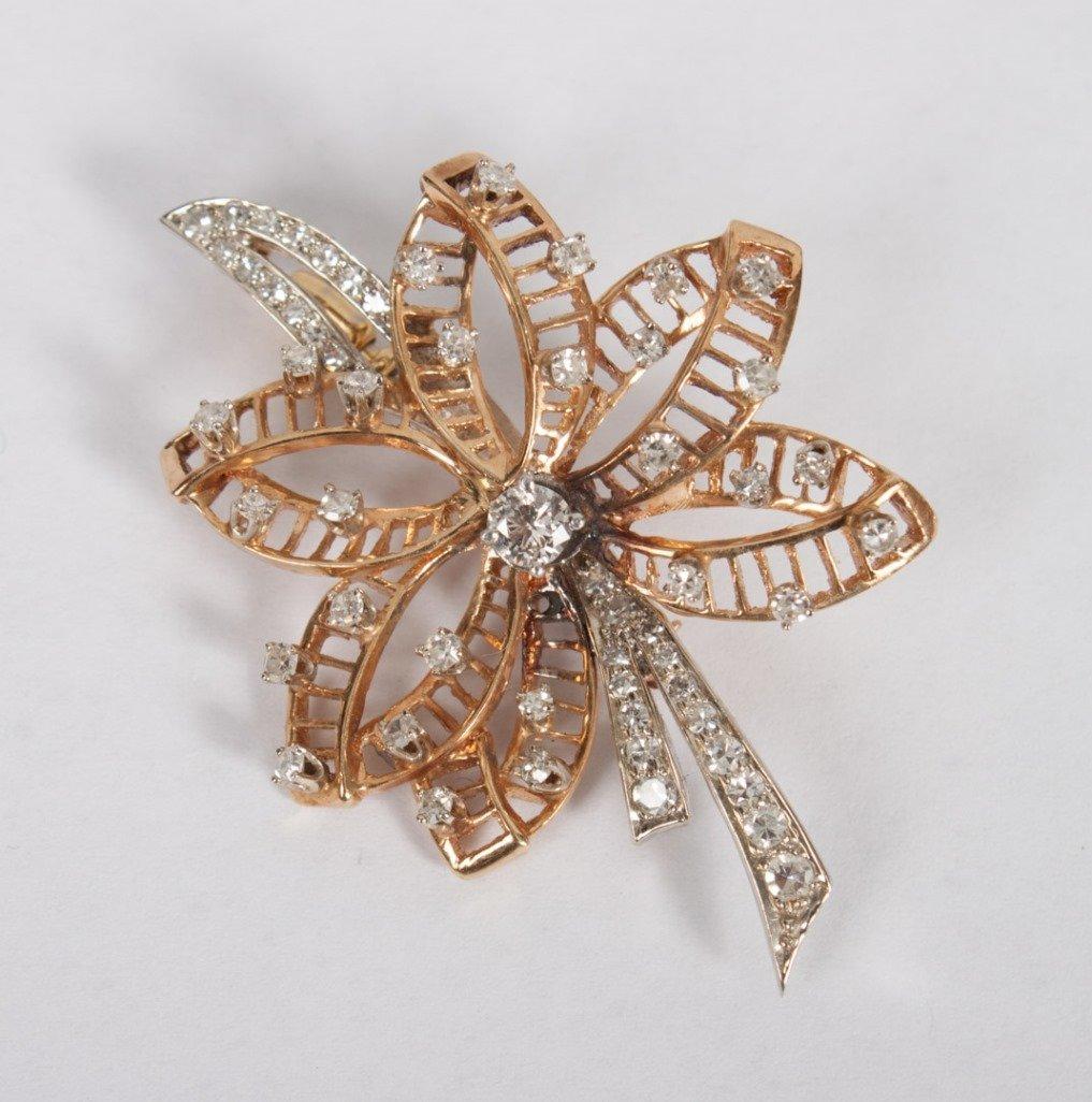 Lady's 14K yellow/white gold & diamond brooch