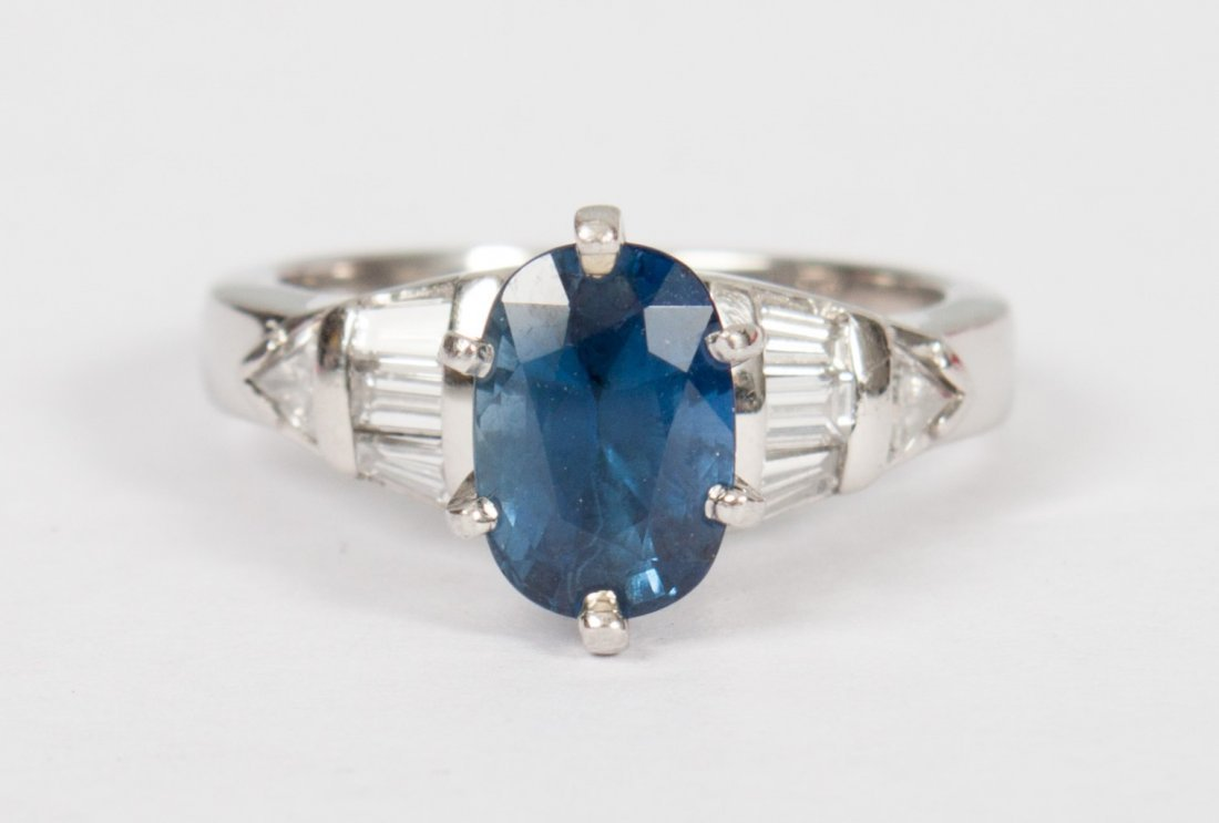 Lady's platinum, blue sapphire & diamond ring
