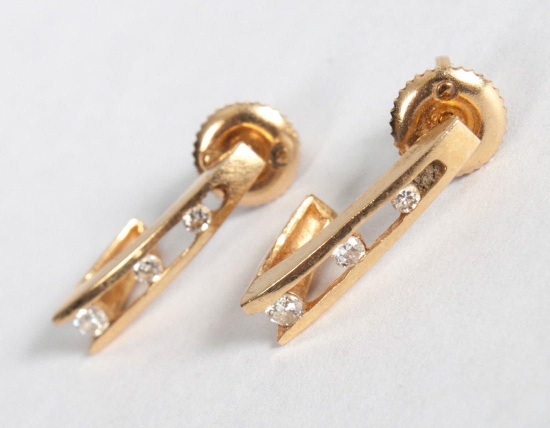 Pair of lady's 14K gold & diamond earrings